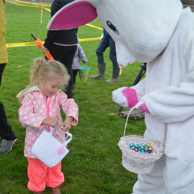 person in easter bunny suit and small child