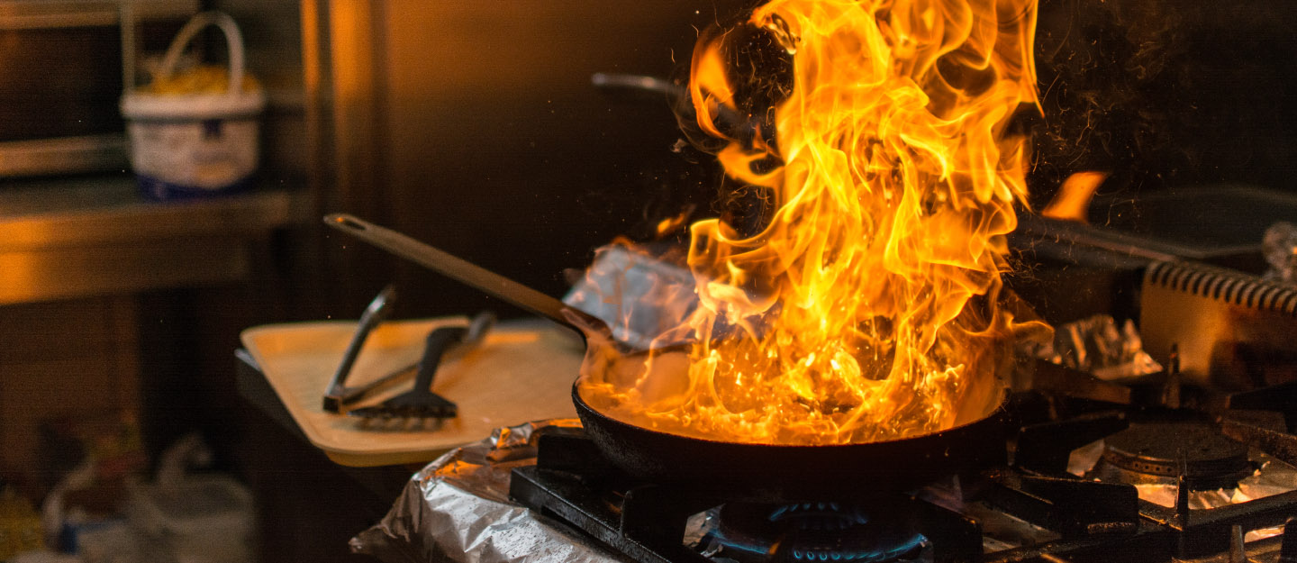 fire in cooking pan on stove