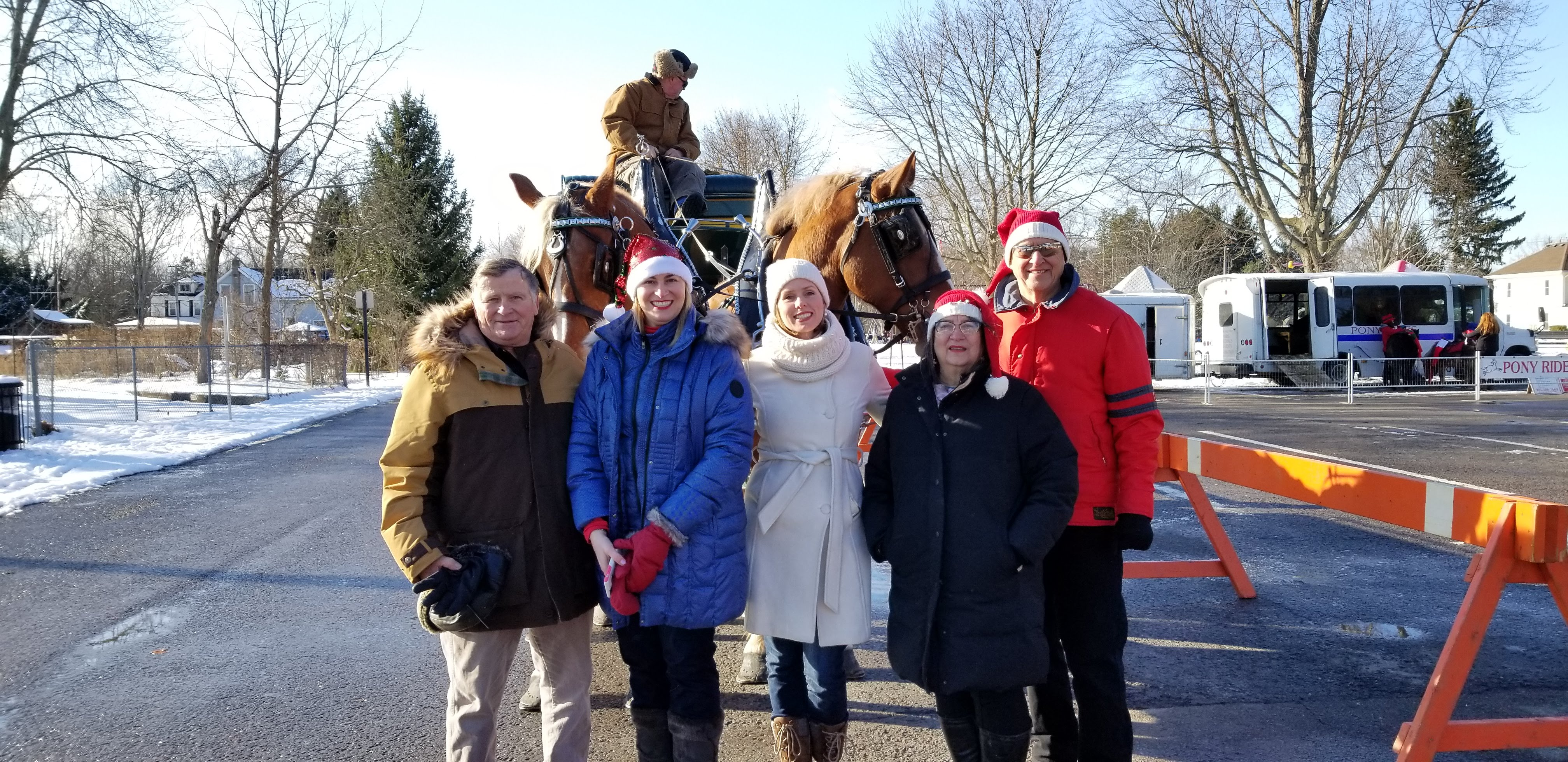 Councillors posing for photo on street during winter parade
