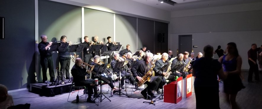 big band set up on stage playing instruments