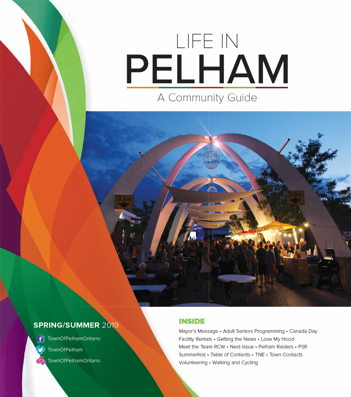guide cover with pelham arches lit up at dusk