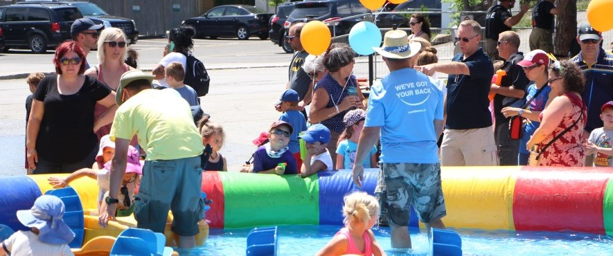kids in floats in inflatable pool at summerfest
