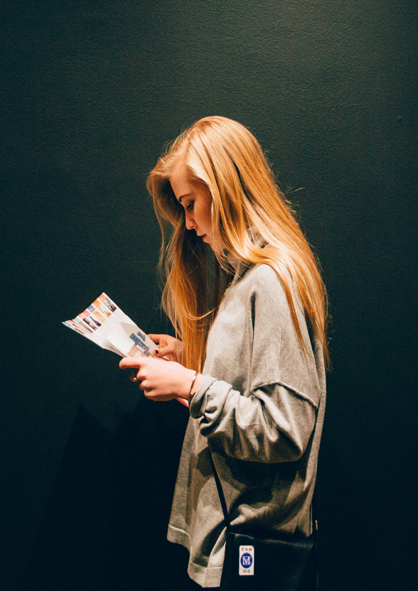 girl reading a brochure